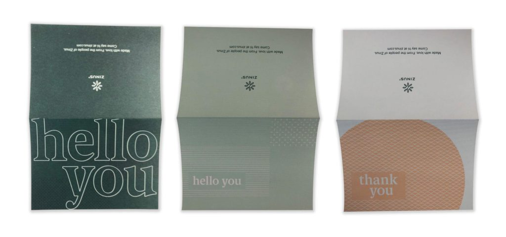 A photo of three blank cards