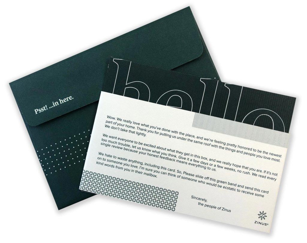 A photo of thank you message on a slip-off band and an envelope
