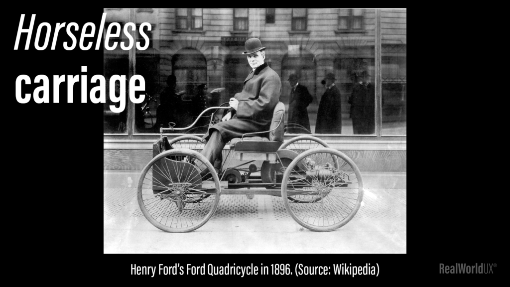 """A picture of Henry Ford's Ford Quadricycle in 1896, with a large text """"Horseless carriage"""" on top."""