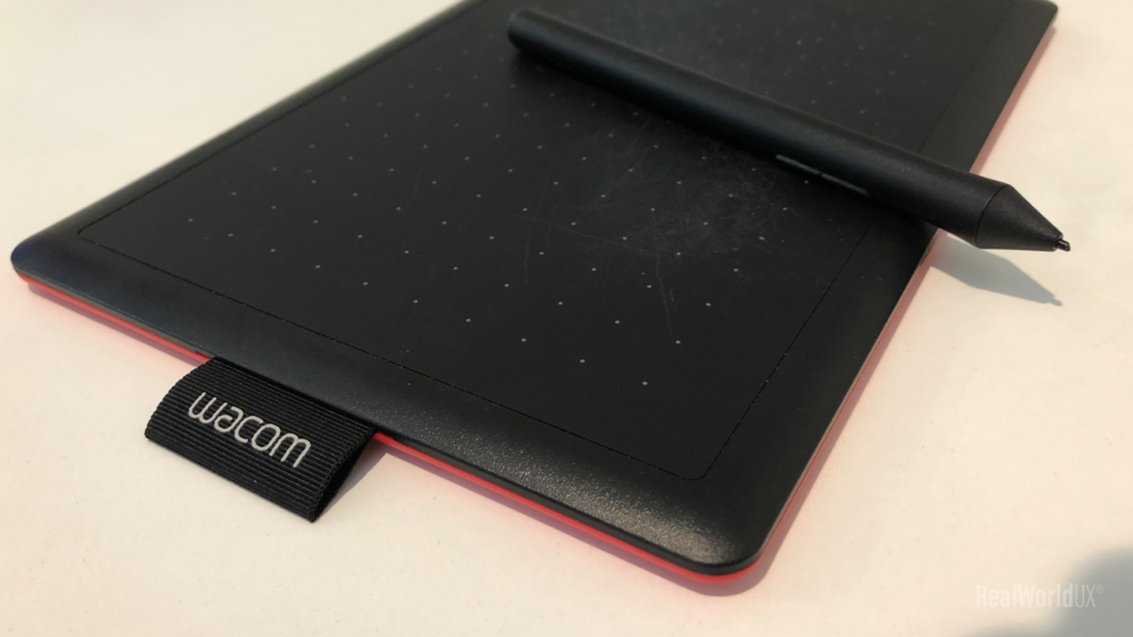 A photo of One by Wacom, showing both a tablet and a stylus pen.
