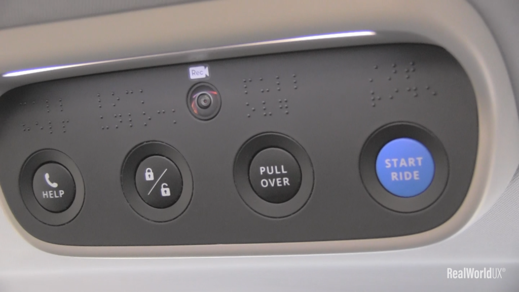 A photo of 4 physical buttons on the ceiling of Waymo.