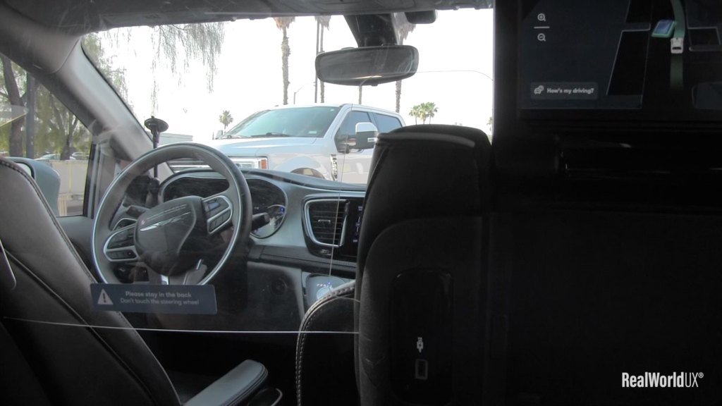 A photo of a large pickup truck blocking the way, seen from inside Waymo.